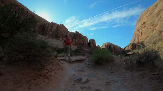 Woman hiking in a canyon near Moab