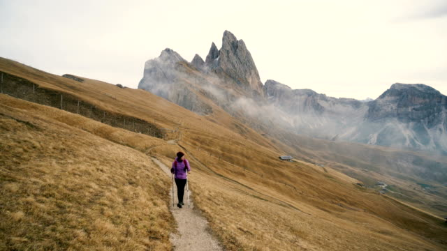 Woman hiking near Seceda mountain in Dolomites video