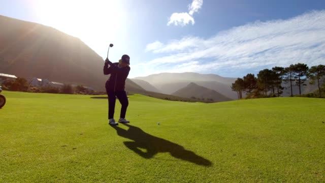 Woman hitting a golf shot