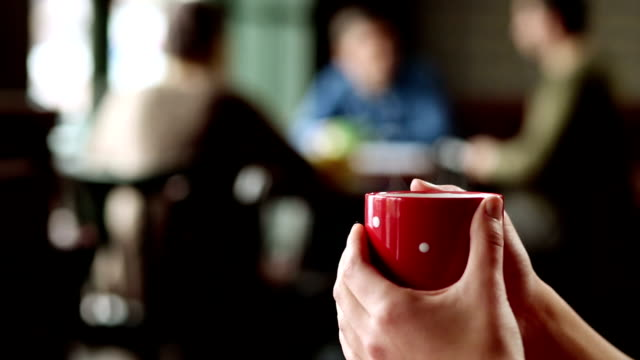Woman holding a coffee video
