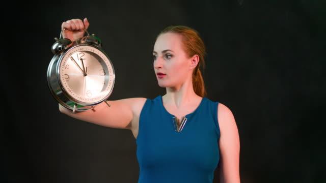 Woman holding clock video
