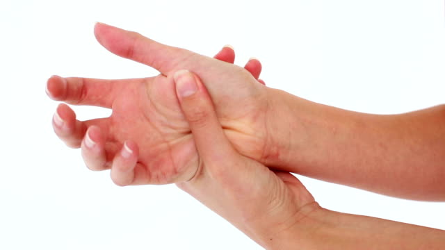 Woman holding her sore hand video