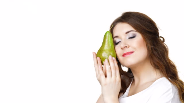 Woman holding pear fruit Woman dark hair holding green pear fruit, recommend detox fruit diet, isolated on white. Healthy dieting, vegan food, vitamins immunity concept. pear stock videos & royalty-free footage
