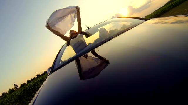 HD SLOW MOTION: Woman Holding Sheet On Open Road video