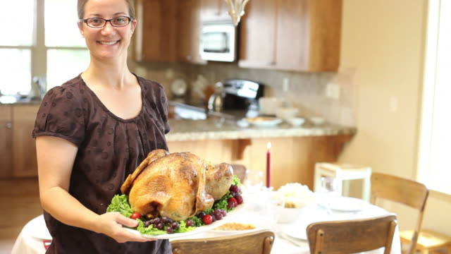Woman holding Thanksgiving turkey video