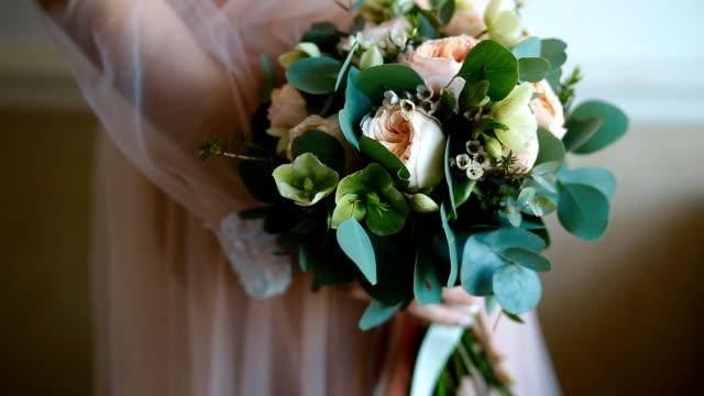 Woman holding wedding bouquet video