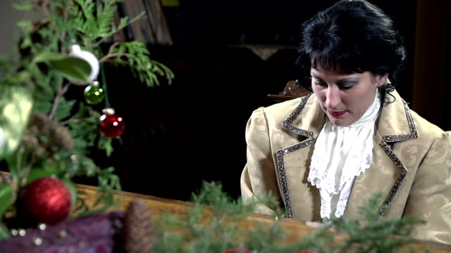 HD SLOW: Woman in 18th century plays the piano skillfully video