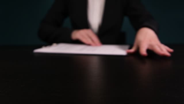 woman in a business suit proposes to sign agreement, promoting printed contract - divorce video stock e b–roll