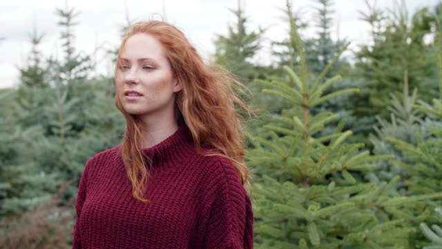 Woman in a coniferous forest