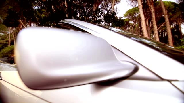 Woman in a silver car