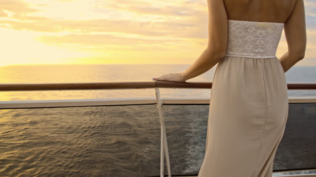 slo mo woman in a summer dress on the ship - cruise video stock e b–roll