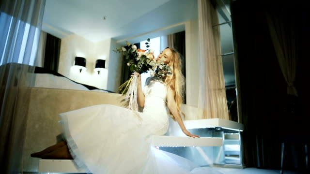 woman in a wedding dress in the room video