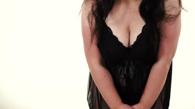 woman in black lingerie showing her breast chest - tułów filmów i materiałów b-roll