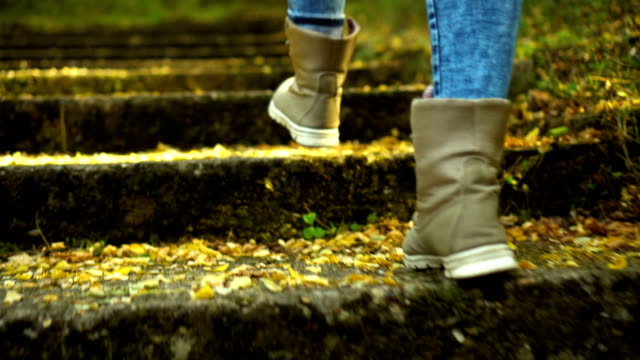 woman in boots climbs the stairs - viaggio d'istruzione video stock e b–roll