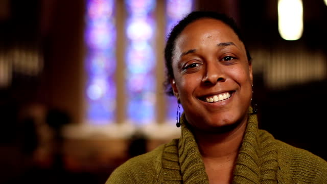 Woman in church, looking at camera video