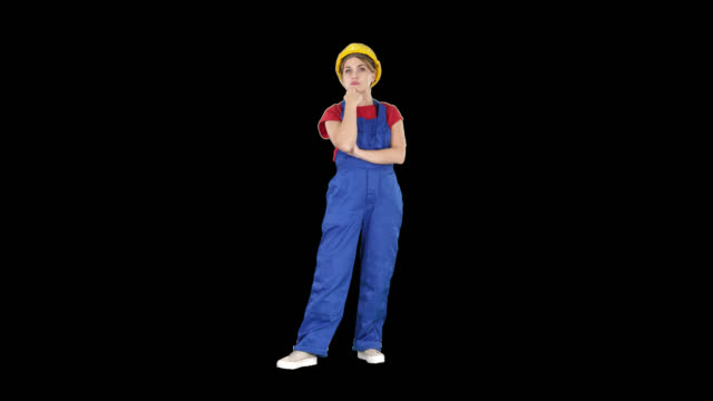 Woman in construction uniform listening to instructions, Alpha Channel