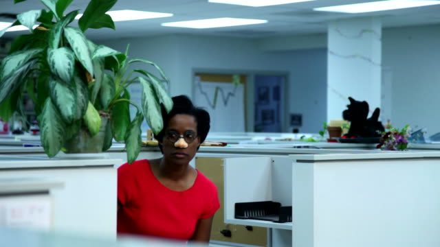 Woman in disguise sneaking around office cubicle video