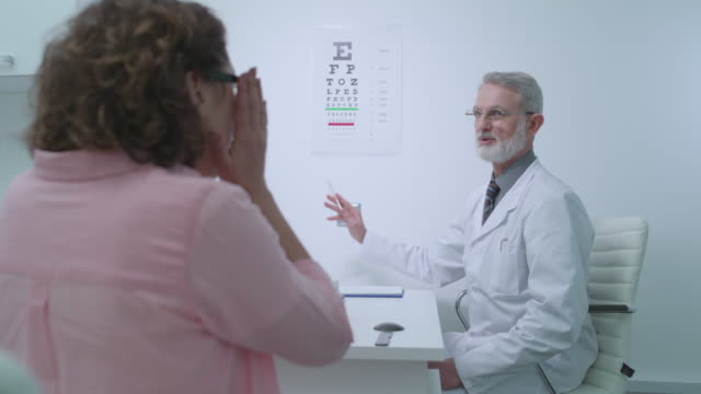 Woman in eyeglasses reading letters on eye chart, ophthalmologist's consultation Woman in eyeglasses reading letters on eye chart, ophthalmologist's consultation eye chart stock videos & royalty-free footage