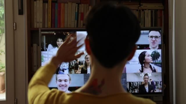 Woman in front of a device screen teamworking in video conference - video