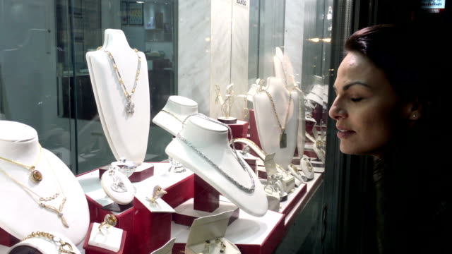 Woman in front of jewelry store. video