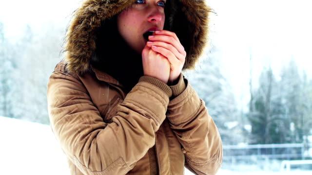 Woman in fur jacket warming her hands video