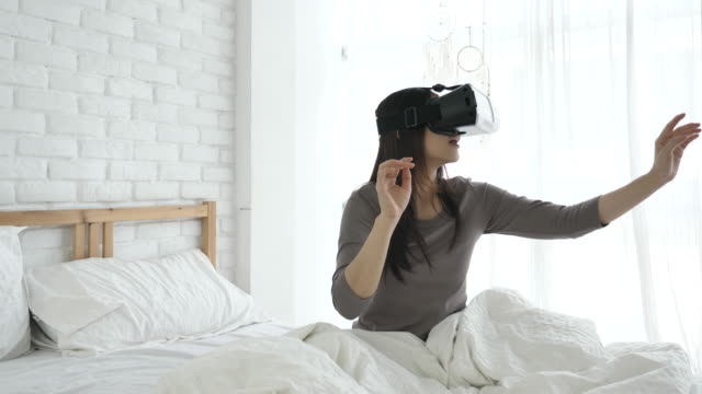 SLO MO Woman in glasses of virtual reality at home video