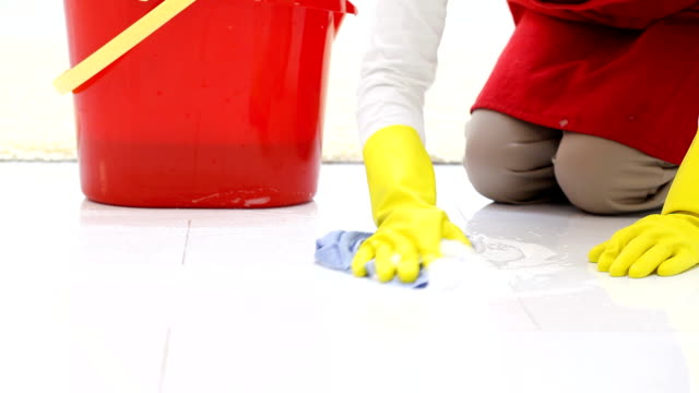 Woman in gloves cleaning a floors. video
