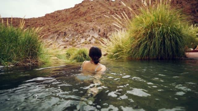 Woman in hot spring in Atacama desert