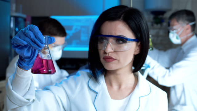 Woman in laboratory working with chemicals video