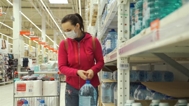 woman in medical mask buying drinking water - face mask stock videos & royalty-free footage