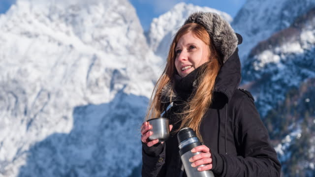 Woman in mountainous background in winter video
