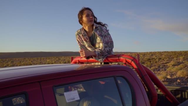 Woman in pickup car in   Atacama desert in Chile