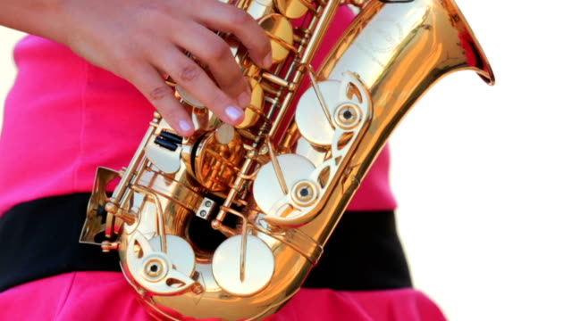Woman In Pink Playing the Saxophone. Close-up video