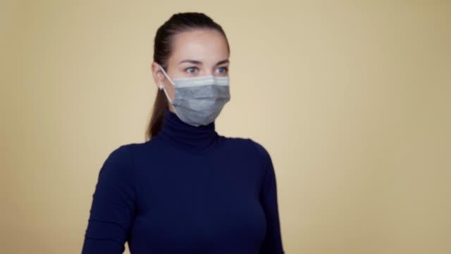 kvinna i skyddsmask sprutar desinfektionsmedel i luften, fokusera på desinfektionsmedel - resistance bacteria bildbanksvideor och videomaterial från bakom kulisserna