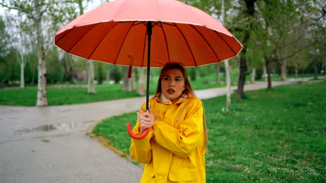 Woman in rainy and cold day at the park