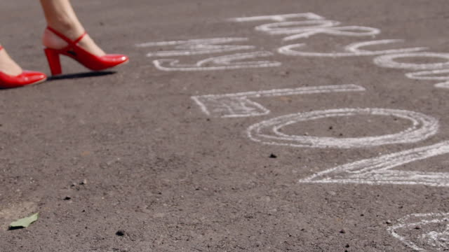 Woman in red shoes on asphalt is to love writing and throwing rose video