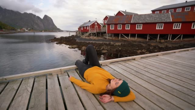 Woman in Reine village in Lofoten Islands