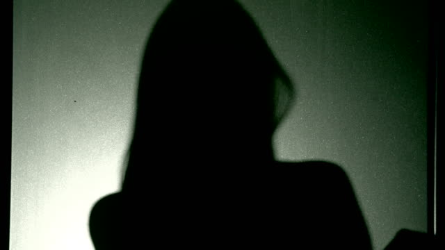 woman in silhouette - femminilità video stock e b–roll