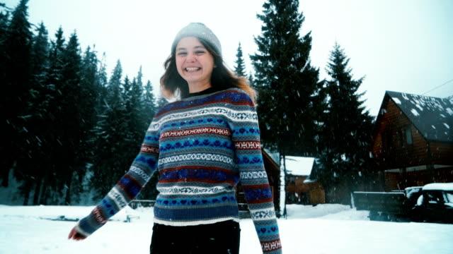 Woman in sweater walking outdoors in winter video