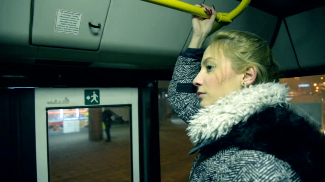 Woman in the bus Video of young woman in public transport. gripping stock videos & royalty-free footage