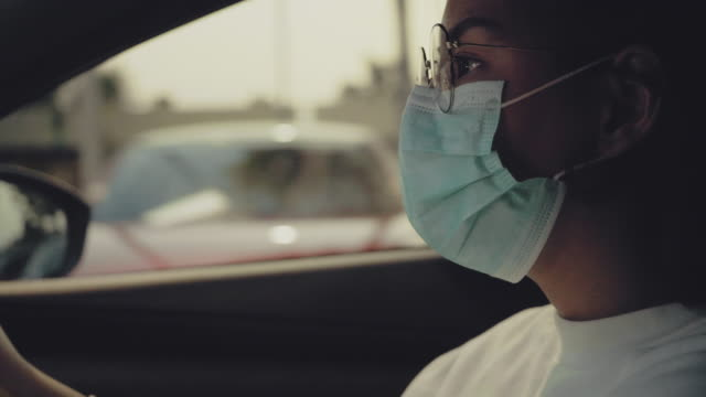 Woman in the car with protective facial mask.Health protection.