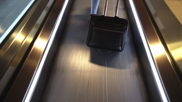 woman in the escalator at the airport woman in the escalator at the airport minority groups stock videos & royalty-free footage