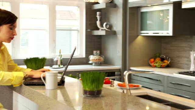 woman in the kitchen - looking inside inside cabinet bildbanksvideor och videomaterial från bakom kulisserna