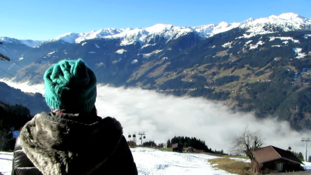 Woman in the mountains looking at beautiful view video