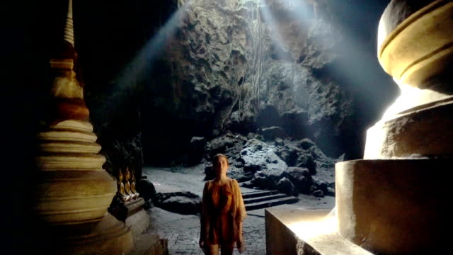 Woman in the temple in cave video
