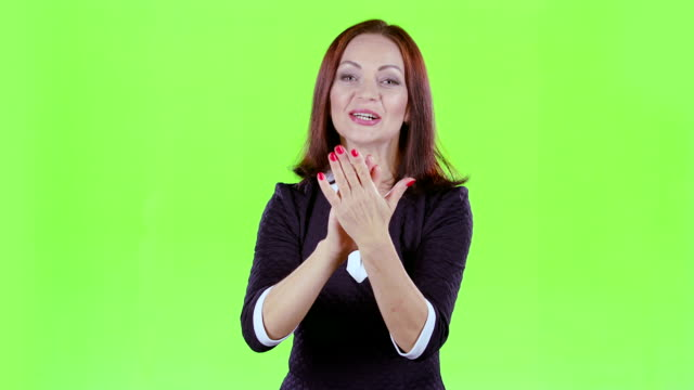 Woman in the theater claps bravely to the actors. Green screen video