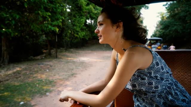 Woman in tuk-tuk   in Angkor Wat  temple video