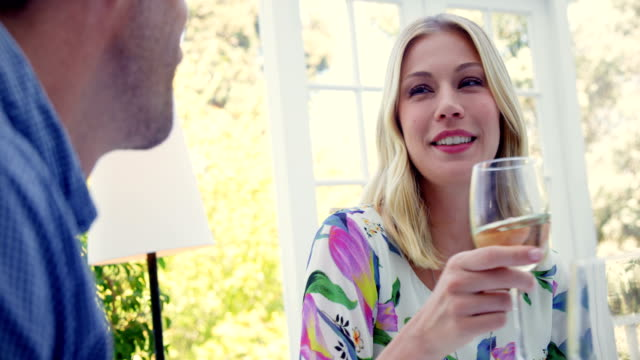 Woman interacting while having wine in restaurant Smiling woman interacting while having wine in restaurant 30 39 years stock videos & royalty-free footage