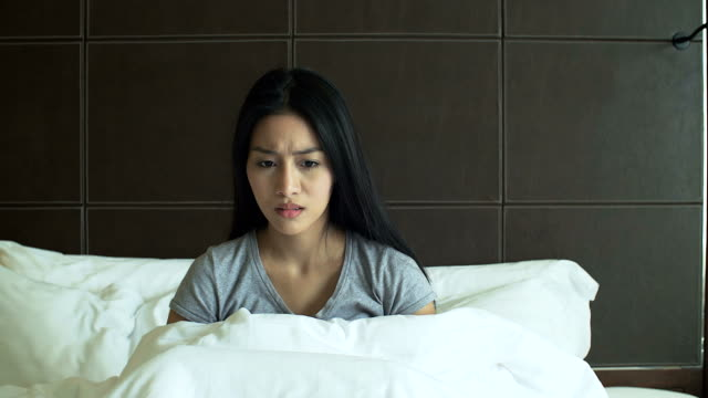 4K: Woman is awaken from nightmare with anxiety feeling video