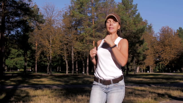 A woman is engaged in fitness with a sports gadget. A woman is engaged in fitness with a sports gadget. panting stock videos & royalty-free footage